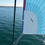 Top down furling asymmetric spinnaker